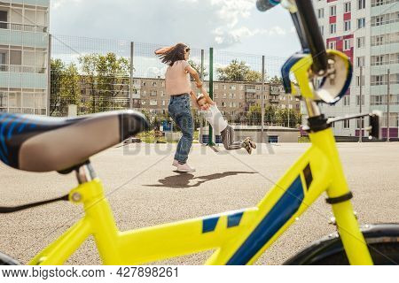 Mom Spins Her Son On The Playground.