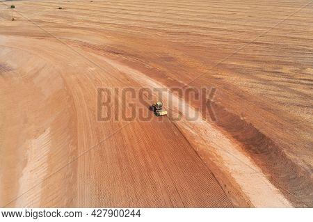 Vibrating Roller For Laying Asphalt Rolls The Soil In The Middle Of The Desert. Roller For Indicatin