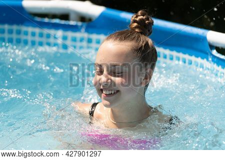 Just To Have Some Fun. Happy Child Swim In Leisure Pool. Leisure Activity. Summertime