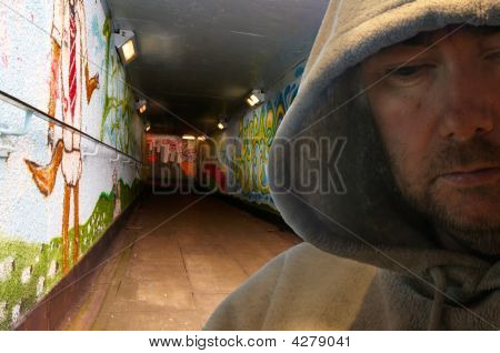 Hooded Man In Graffiti Decorated Subway
