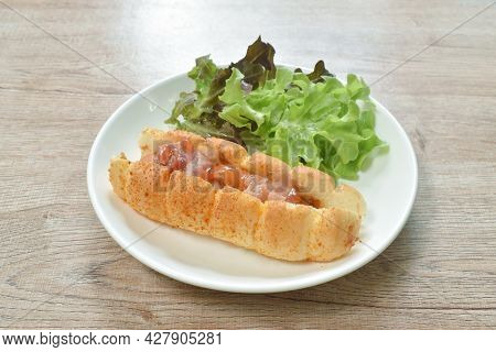 Hot Dog Stuffed Smoky Pork Sausage And Slice Bacon With Lettuce Dressing Ketchup On Dish