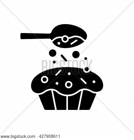Sprinkle For Baking Black Glyph Icon. Pouring Topping From Spoon On Cupcake. Dessert Recipe. Cooking