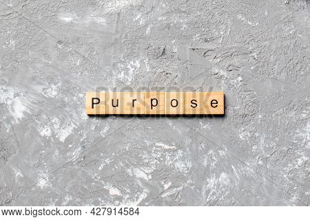 Purpose Word Written On Wood Block. Purpose Text On Table, Concept