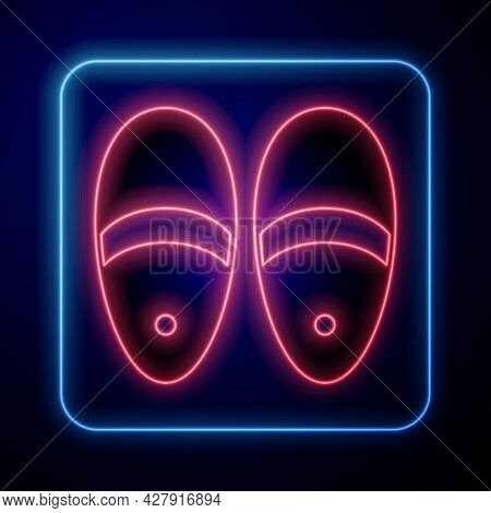 Glowing Neon Slippers Icon Isolated On Black Background. Flip Flops Sign. Vector