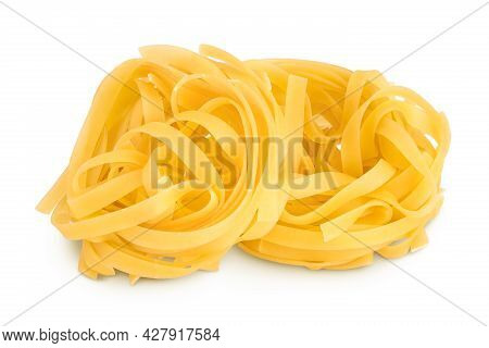 Raw Tagliatelle Pasta Isolated On White Background With Clipping Path And Full Depth Of Field