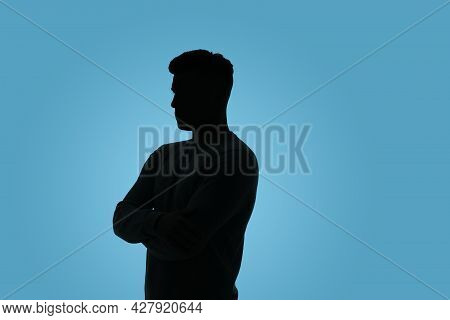 Silhouette Of Anonymous Man On Light Blue Background