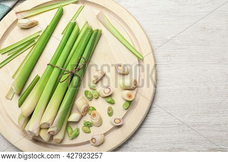 Fresh Lemongrass On White Wooden Table, Flat Lay. Space For Text