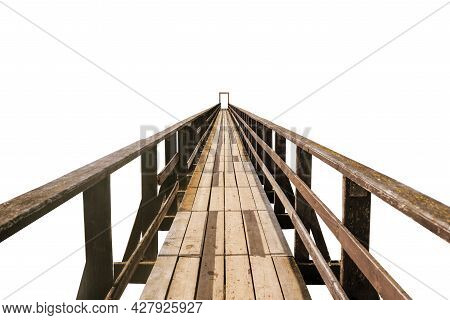 Old Wooden Bridge Isolated On A White Background. A Pathway Pedestrian Bridge Extending Into The Hor