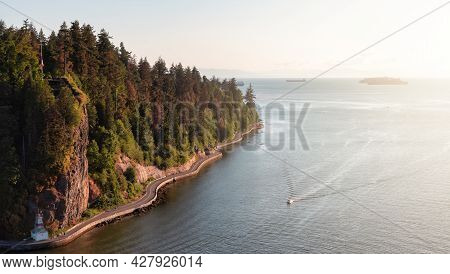 Aerial View From Lions Gate Bridge Of Famous Seawall In Stanley Park. Sunny Summer Sunset. Downtown