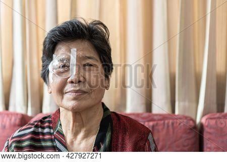 Cataract Elderly Patient, Asian Old Senior Woman Having Eye Care Treatment On Age-related Eye Diseas