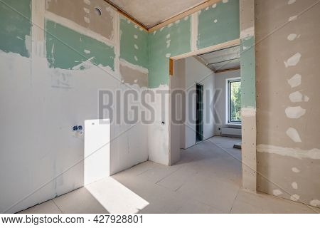 Empty Unfurnished Room With Minimal Preparatory Repairs. Interior With White Walls And Drywall