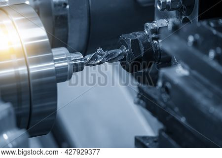 The  Cnc Lathe Machine Hole Cutting The Metal Shaft Parts. The Hi-technology Metal Working Processin