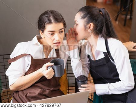 Beautiful Caucasian Barista Women Feel Wonder After Hearing Message From Another Barista In Coffee B