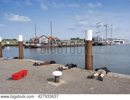 Oudeschild, Netherlands, 19 July 2021: Old Wooden Sailing Vessels In Port Of Oudescild On Dutch Isla