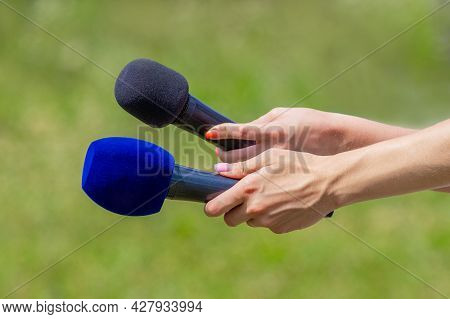Microphones In The Hands Of Journalists During For News Interview Outdoors