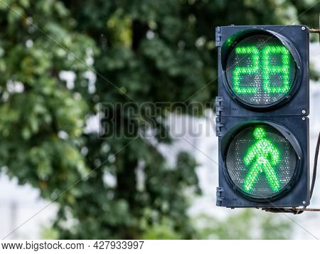 Traffic Light With Green Light And Timer On Blurred Background. The Traffic Light Signals That Traff