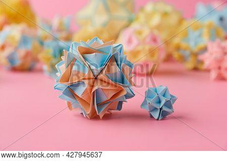 Set Of Multicolor Handmade Modular Origami Balls Or Kusudama Isolated On Pink Background. Visual Art