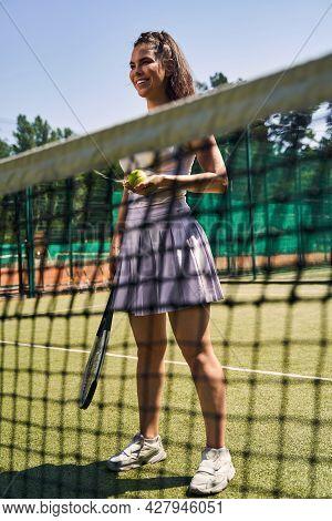 Cute Dark-haired Joyous Sportswoman On The Court