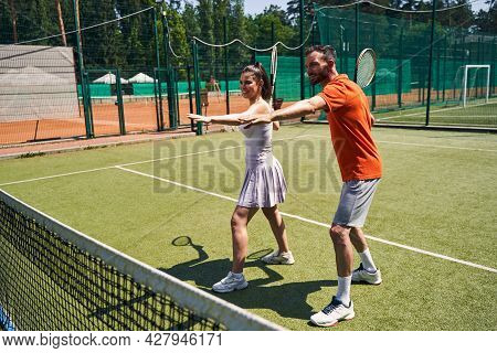 Female Client Taking A Private Beginner Tennis Lesson