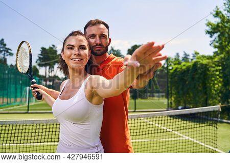 Female Beginner Tennis Player Mastering The Correct Hand Motion