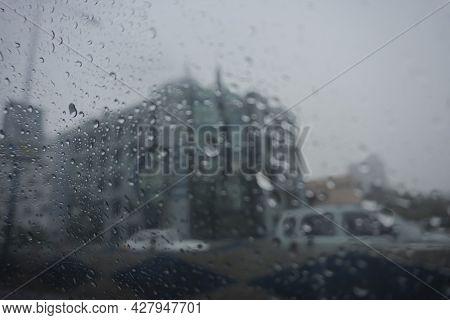 Image Shot Through Raindrops Falling On Wet Glass, Abstract Blurs - Monsoon Stock Image Of Kolkata (