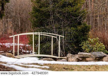 Low Angle Scenic View To Wooden Footbridge At Lazdukalni Dendrologic Park In Ogre, Latvia.  Idyllic