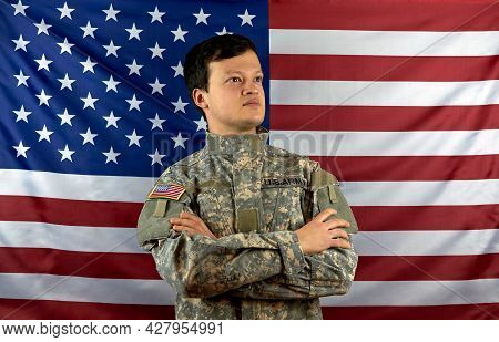 American Soldier On The Background Of The Flag. Portrait Of A Us Army Soldier.