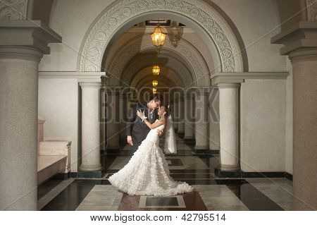 A Beautiful Bride And Handsome Groom At Christian Church During Wedding . poster