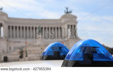 Blue Sirens Of Police  Car And The Ancient Monument Called Altare Della Patria In Background In Rome