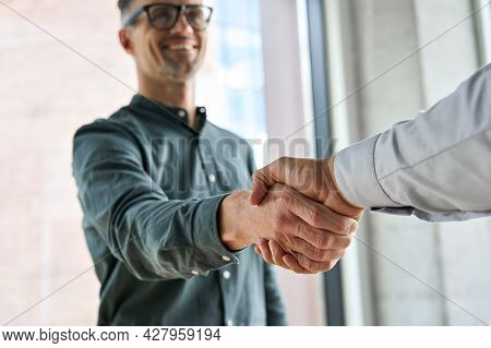 Two Happy Diverse Professional Business Men Executive Leaders Shaking Hands At Office Meeting. Smili