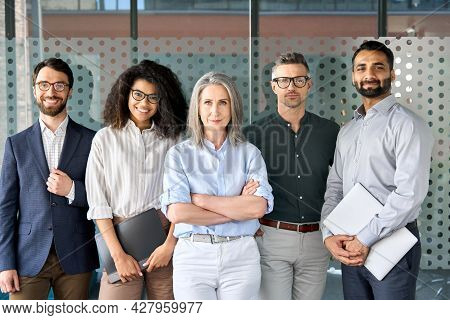 Happy Diverse Business People Team Standing Together In Office, Group Portrait. Smiling Multiethnic