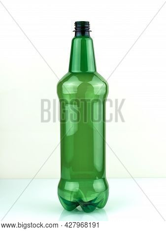 Green Plastic Bottle. Empty Green Bottle On A White Background. Plastic Beer Bottle. Pet Bottle.