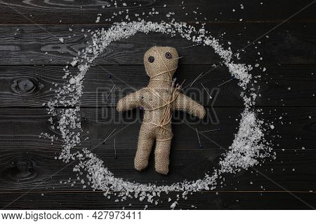 Voodoo Doll And Pins In Salt Circle On Black Wooden Table, Flat Lay