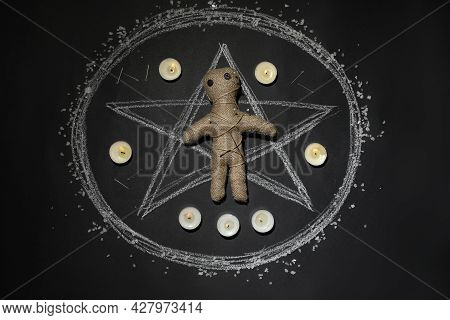 Voodoo Doll Pierced With Pins And Candles In Pentagram On Table, Flat Lay