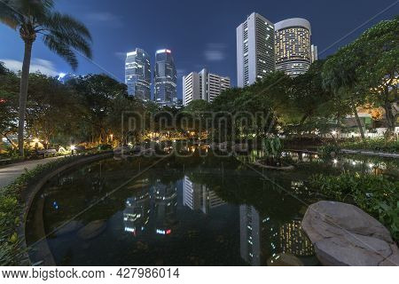 High Rise Office Building And Public Park In Midtown Of Hong Kong City At Night