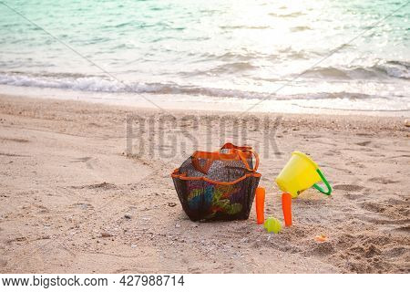 Toy On Sand Beach At Coast With Blue Sea And Sunlight. Tropical Ocean Nature On Day For Family Touri