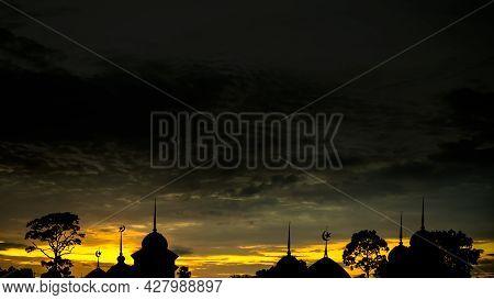 Ramadan Kareem Religion Symbols. Mosques Dome In Twilight Night Sky Dark Black And Yellow Background