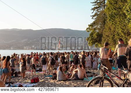 Vancouver, British Columbia, Canada - July 20, 2021: Crowd Of People Partying At The Beach During Th