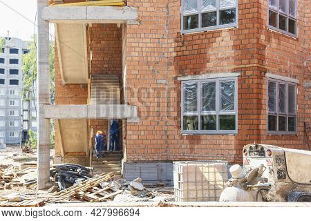 Construction Of A Red Brick Multi-storey Building. The Use Of Scaffolding When Building A House. Ind