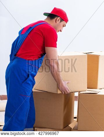 Contractor worker moving boxes during office move
