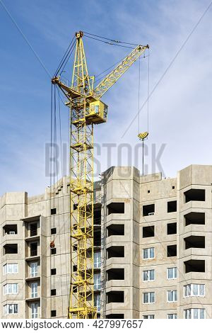 The Work Of A Tower Crane During The Construction Of A Panel House Made Of Reinforced Concrete. Mode