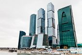 new Moscow city office center glass towers in overcast day poster