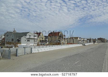 Protective barrier build to prevent damage in devastated area one year after Hurricane Sandy