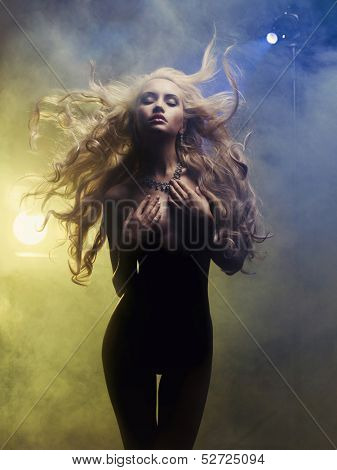Fashion art photo of diva coming out of the smoke