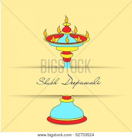 Shubh Dipawali (Happy Dipawali) concept with illuminated colorful tradition oil lit lamp on abstract background for celebration of Indian festival of lights.