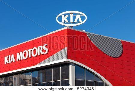 Samara, Russia - October 20: The Emblem Kia Motors On Blue Sky Background, October 20, 2013 In Samar