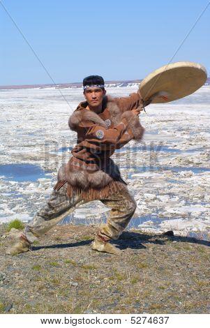 Chukchi mah in folk dress is in folk dance position