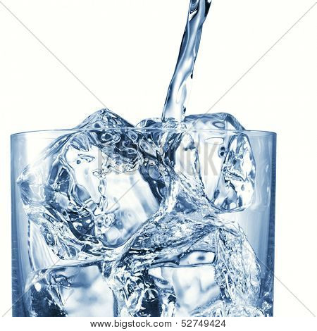 Pouring water in Glass with perfect ice isolated on white