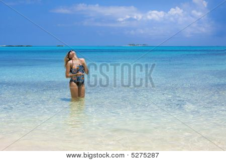 Woman Relaxing In The Ocean