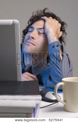 Tired Man At Computer Desk